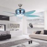 Electrician Singapore is performing an electrical service. He installs a blue ceiling fan with light