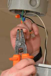 An electrician that works in Singapore is now using an electrical wire stripper to remove the insulated electrical conductor.