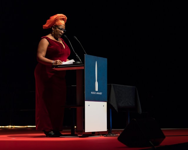 Nalo Hopkinson at the Hugo Award Ceremony 2017, Worldcon in Helsinki. Credits: Henry Söderlund CC BY 4.0. Photo link: https://commons.wikimedia.org/wiki/Category:Nalo_Hopkinson#/media/File:Nalo_Hopkinson,_at_the_Hugo_Award_Ceremony_2017,_Worldcon_in_Helsinki.jpg. CC link: https://creativecommons.org/licenses/by/4.0/