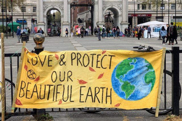 """Banner reading """"Save & Protect Our Beautiful Earth"""""""