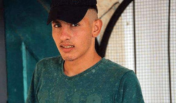 Young man wears T-shirt and baseball cap