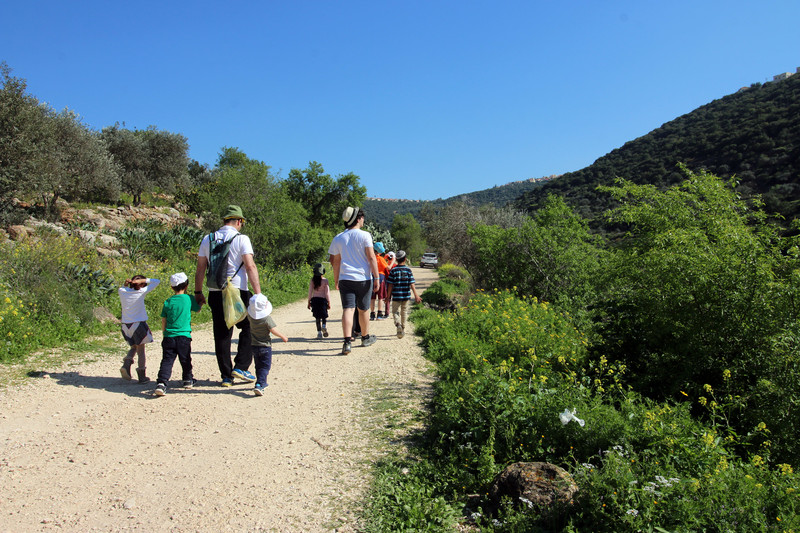 Israelis walking with children
