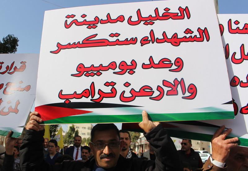 Man holds banner