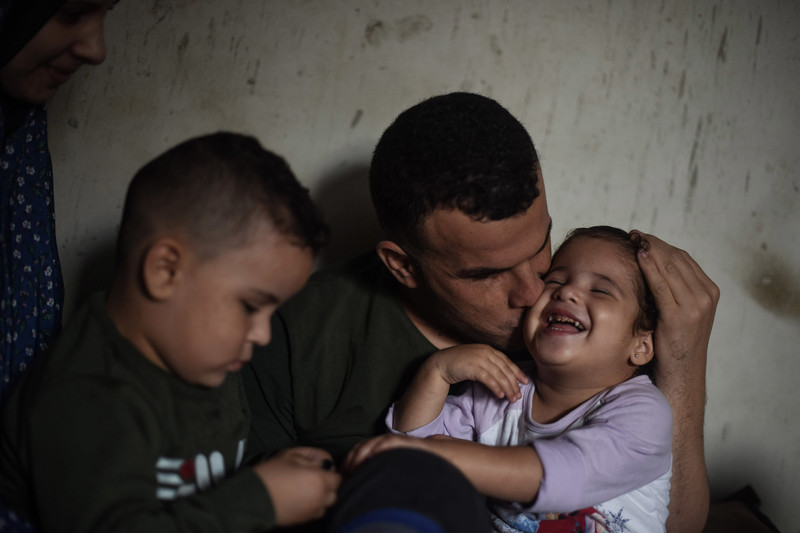 Man kisses child on the cheek