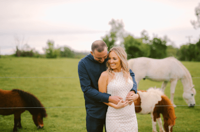 Horses in the background of engagement photos