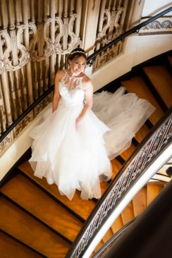 Bride walking down stairs at Grand Island Mansion