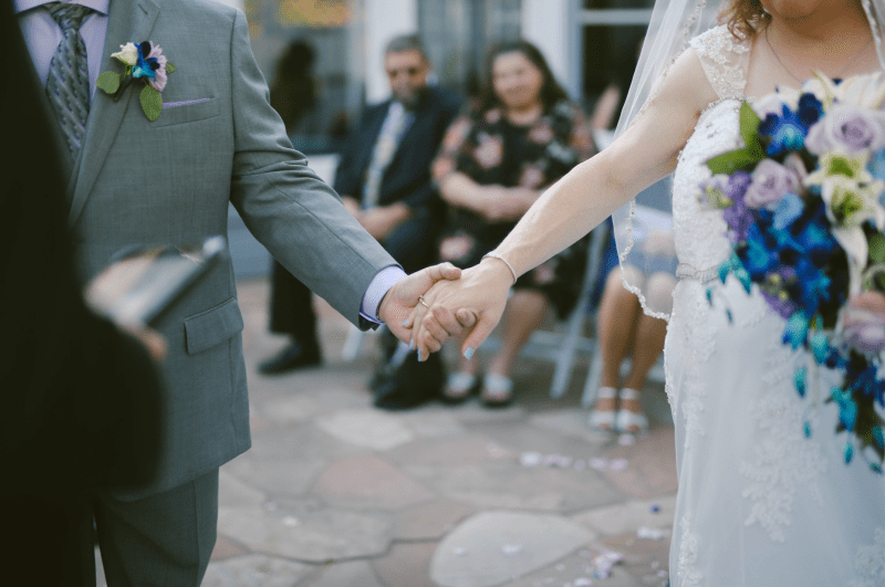 Bride holding hands with groom