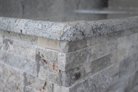Outdoor Kitchen Builder of Fort Myers, Florida. Close-up of Granite and Stacked Stone