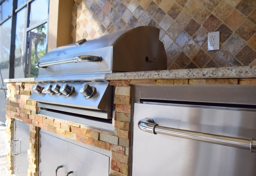 Close-up of Bull BBQ Grill and Custom Stainless Steel Doors and Refrigerator