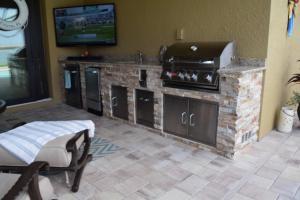 Golden White Stacked Stone & Giallo Granite Finish - Elegant Outdoor Kitchens of Southwest Florida