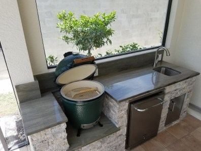 Open Big Green Egg Grill With Silver Travertine Stacked Stone