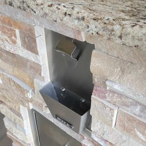 Outdoor Kitchen Bull Bottle Opener - Close-up of Golden White Stacked Stone & Giallo Granite