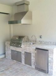 Custom Outdoor Kitchen - Pairing the extremely popular Silver Travertine stacked stone and the Dallas White granite