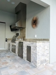 Outdoor Kitchen with Level 1 Santa Cecilia Granite & Silver Travertine Stacked Stone