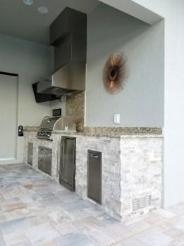 Outdoor Kitchen with Level 1 Santa Cecilia Granite & Silver Travertine Stacked Stone