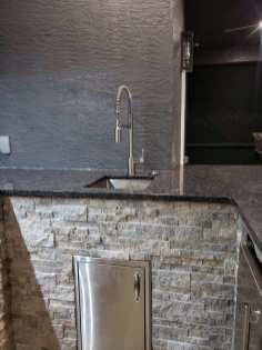 Outdoor kitchen with High Arc sink