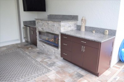 Built-in rectangular fire pan Collier Co. The fire pan was installed by Elegant Outdoor Kitchens of Southwest Florida.