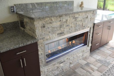 Fire feature cabinet with stacked stone and granite top