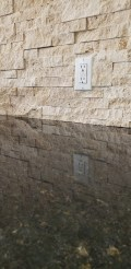 Light Travertine stacked stone backsplash