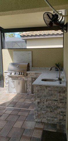 Barbecue Island - A Transformation - Materials used were Silver Travertine stacked stone with a beautiful Level 3 Snow White granite
