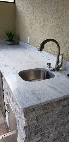 Silver Travertine Stacked Stone with Level 3 Snow White Granite Countertop Combination