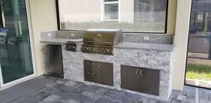 Custom Summer Kitchen by Elegant Outdoor Kitchens of Southwest Florida - Linear Skyline Stacked Stone Level 1 Luna Pearl Granite