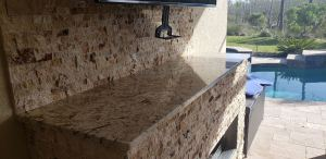 Custom Outdoor Fireplace by Elegant Outdoor Kitchens of SWFL