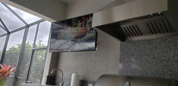 The Sealoc Outdoor-Rated Television is Conveniently Located So the Chef can partake in a little TV while grilling