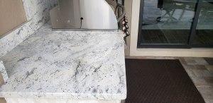 countertop & side/backsplash is level 3 Andromeda White granite.