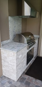 """Installed was a Blaze Traditional Series 32"""" 4 – burner grill, and the facade is a Silver Travertine stacked stone. The countertop & side/backsplash are level 3 Kashmir Gold granite."""