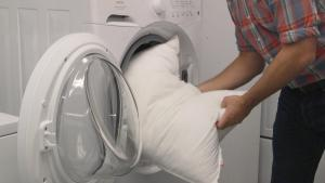 Washing pillows is one of the ways of how to get dog smell out of outdoor furniture