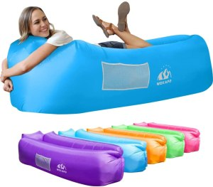 A lady sleeping on Wekapo, one of the best outdoor inflatable lounger