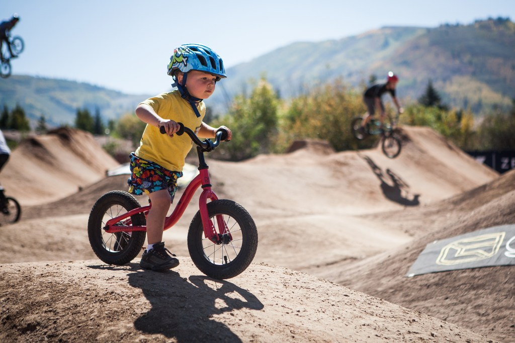 Two-year-old OWen Porter drops in at the Park City dirt jump park.