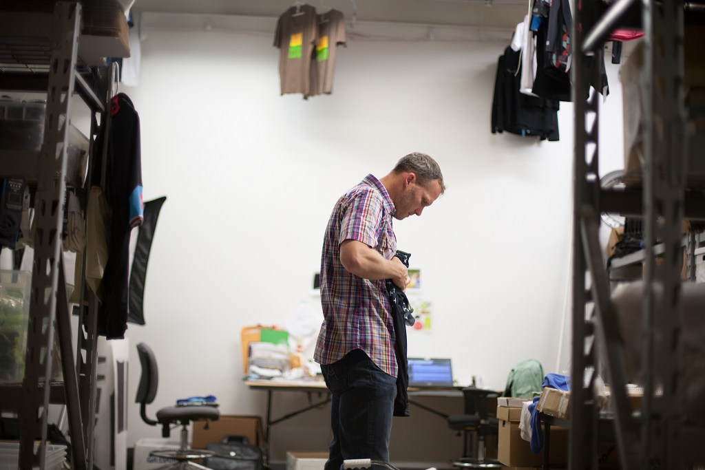 Founder and designer Paul Krumrich folds a jersey at Donkey Label in Minneapolis. (Photo: David Pierini)