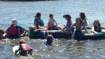 The group undertook a journey across the vlei in their giant water-snake rubber raft