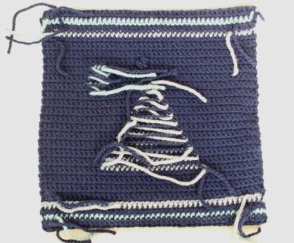 The moonrise crochet pillow back side