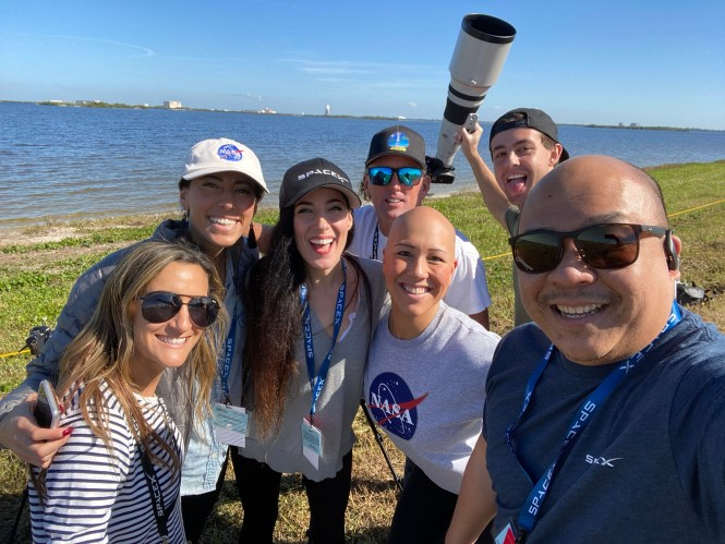 Some of the NASA Social participants smiling after the SpaceX rocket launch.