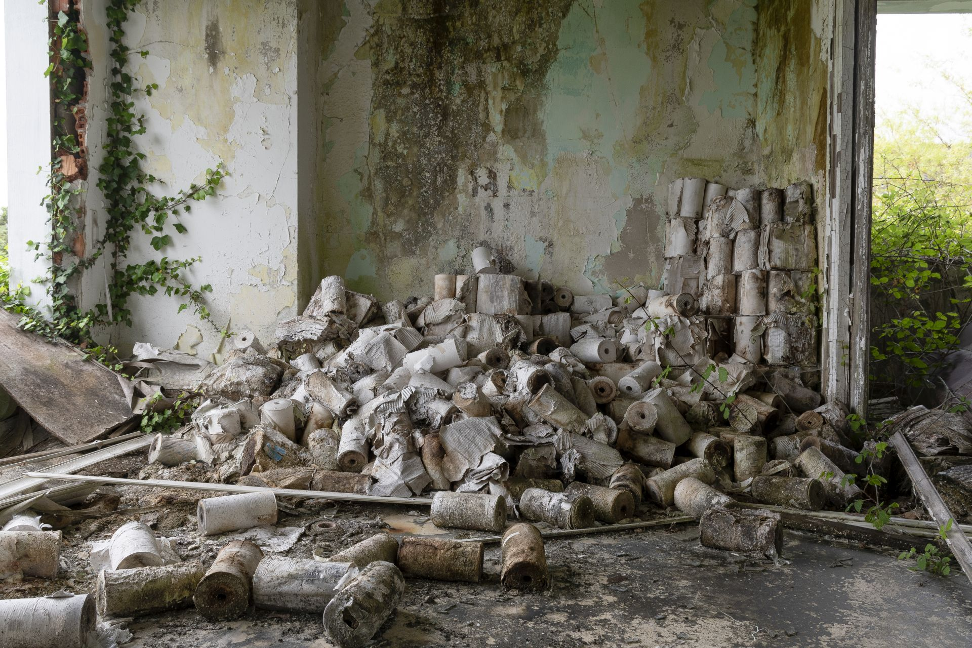 urbex photograph of abstract colours and textures, picture taken in ferrol, galicia. Rolles of paper, military base.