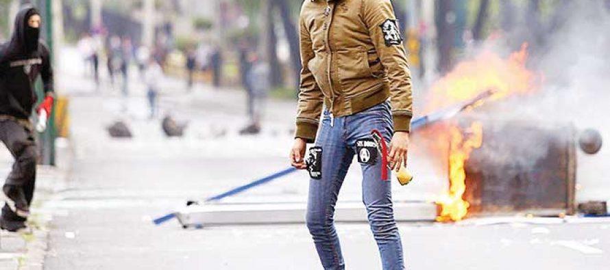 Anarchists blockade Avenida Insurgentes Sur in Mexico City on Wednesday.