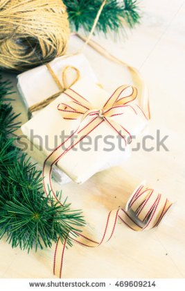 stock-photo-christmas-presents-in-rustic-style-with-holiday-decorations-selective-focus-toned-image-469609214