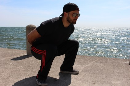 Squat w/ hands behind the back