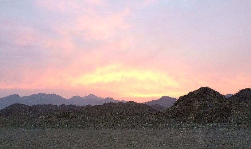 mountains on the horizon with sunset
