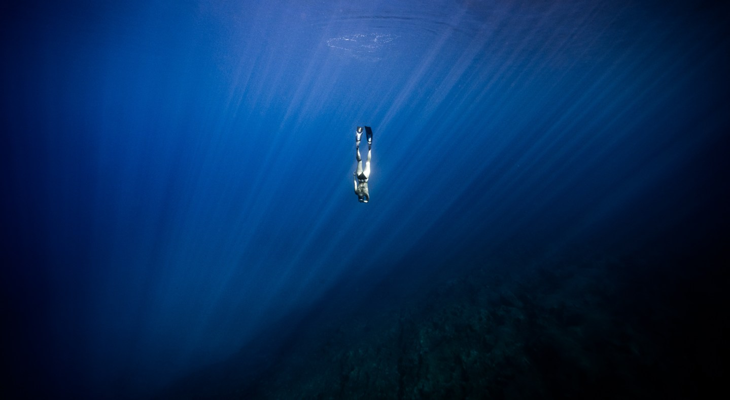 Female freediver in deep water - Nicole Edensbo