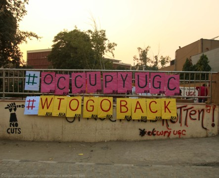"""The twin narratives of """"#OccupyUGC"""" and """"WTO GO BACK"""" have been amplified in clear, daunting terms within the protest space. """"We are occupying the UGC because we want the WTO to stay away"""". It seems like the recent decisions made by the UGC directly reflect India's gradual move towards full-fledged de-welfarisation and privatisation of the Indian higher education system. The movement participants routinely emphasise on how the one-point objective of the demonstrations is to simply stop India from signing the WTO-GATS Agreement when the member states meet in Nairobi between 15-18 December."""