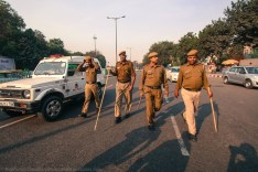 At the tail-end of the march, this file of policemen and the slothfully-moving Delhi Police 'Gypsy' kept a watch on wanderers.