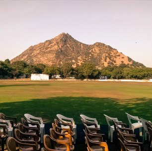 A smaller peak in the Aravalli Range towers over the main school grounds   As seen from the Bikaner Pavilion.