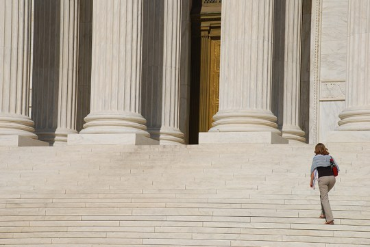 Woman walking up Steps of US Supreme Court