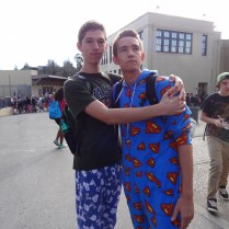 Seniors Henry Moss and Sam Lewis channel their inner superhero and cartoon characters with their printed pajamas.