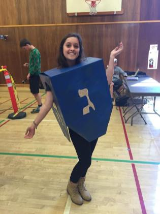 Senior Yasho Enz dresses as a dreidel to represent Hannukah