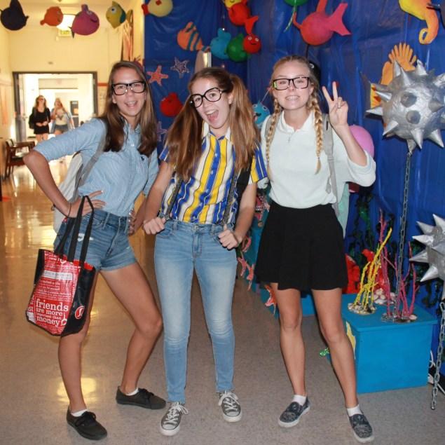 Students dressed as mathletes explore the main hall